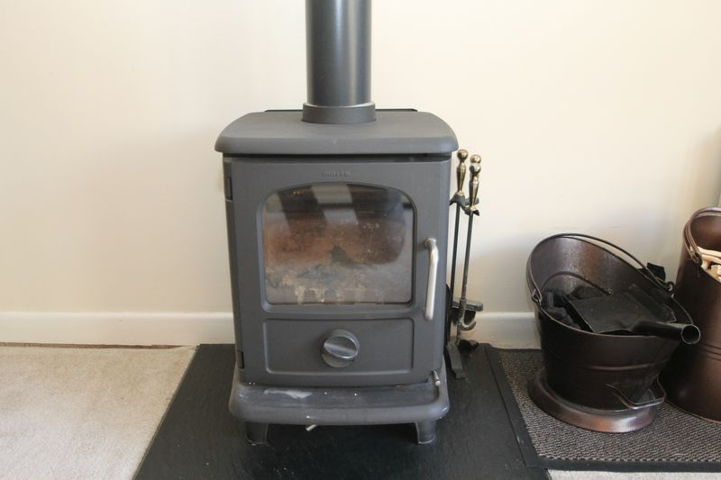"""Morso"" multi-fuel stove in sitting room diner"