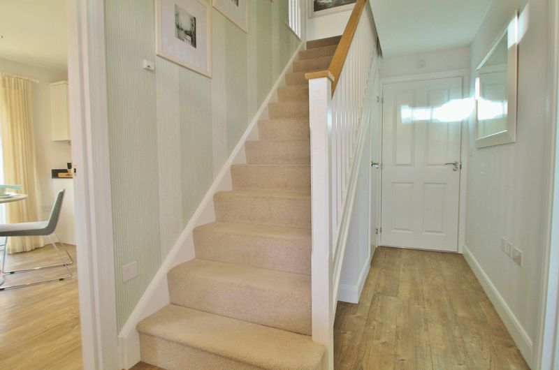 Show home hallway with cloakroom