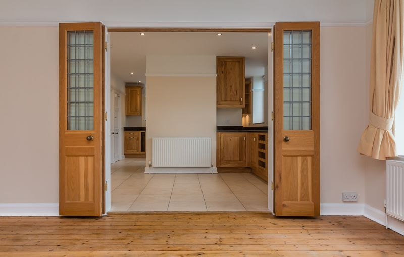 Doors to kitchen/dining room