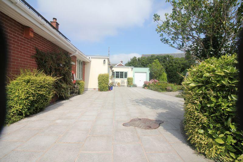 Extensive Driveway & Mature Front Gardens