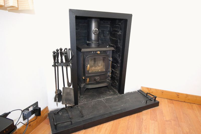 FIREPLACE WITH STOVE IN DINING ROOM
