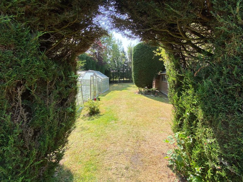 View through Archway to mid section of garden
