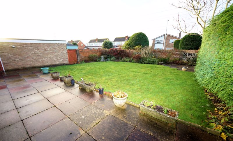 Large patio and lawn