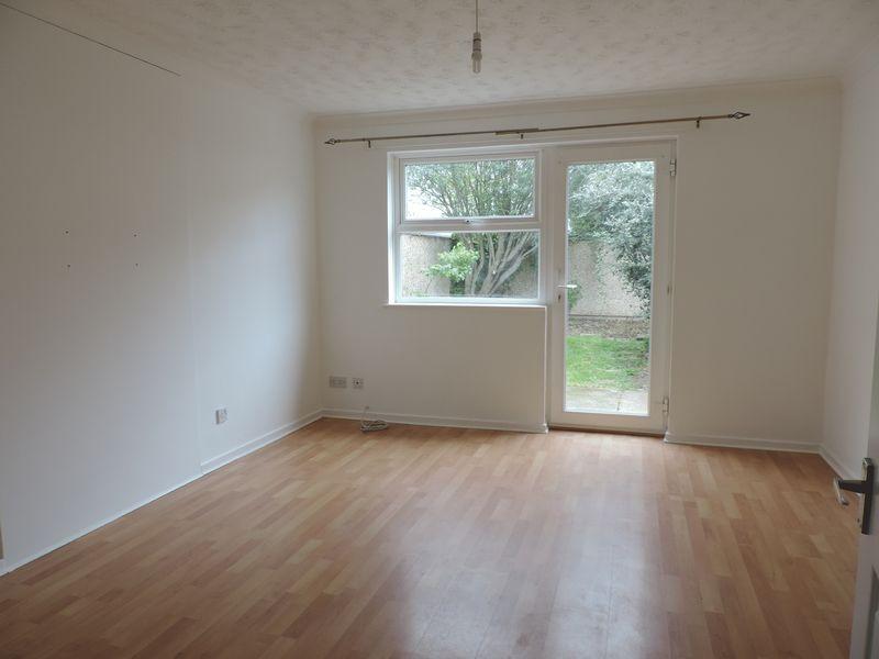 Living room with door to garden