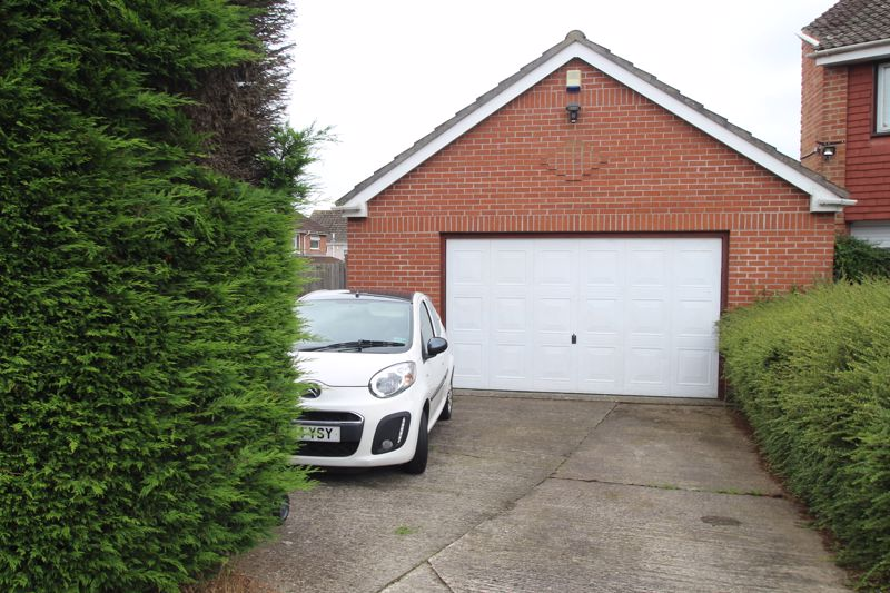Double detached garage and double width driveway