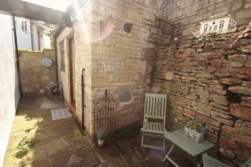 Rear courtyard leading to utility house