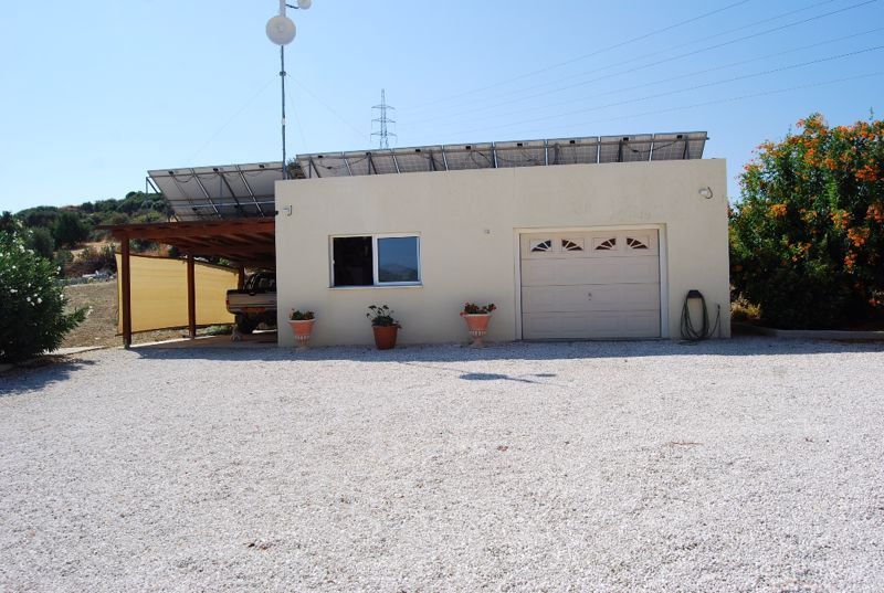Separate double garage and car port
