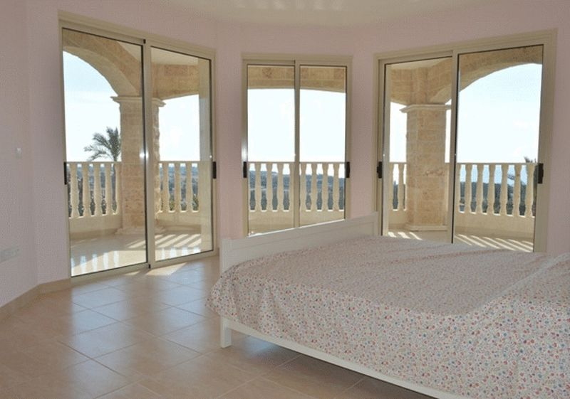 Bedroom With Access To Large Veranda