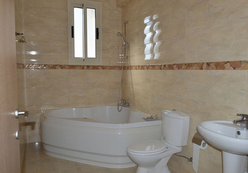Modern Bathroom With Corner Bath And Shower
