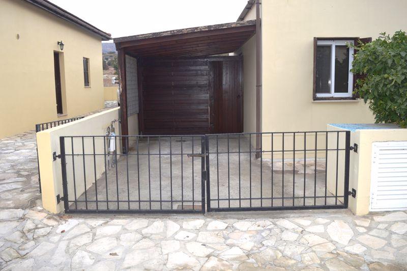 Gated driveway car port