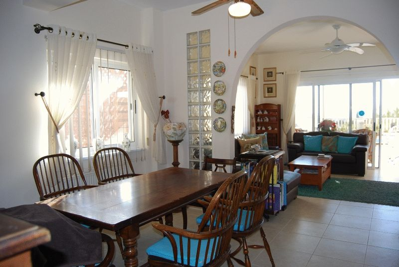 Dining Area with Archway to Lounge
