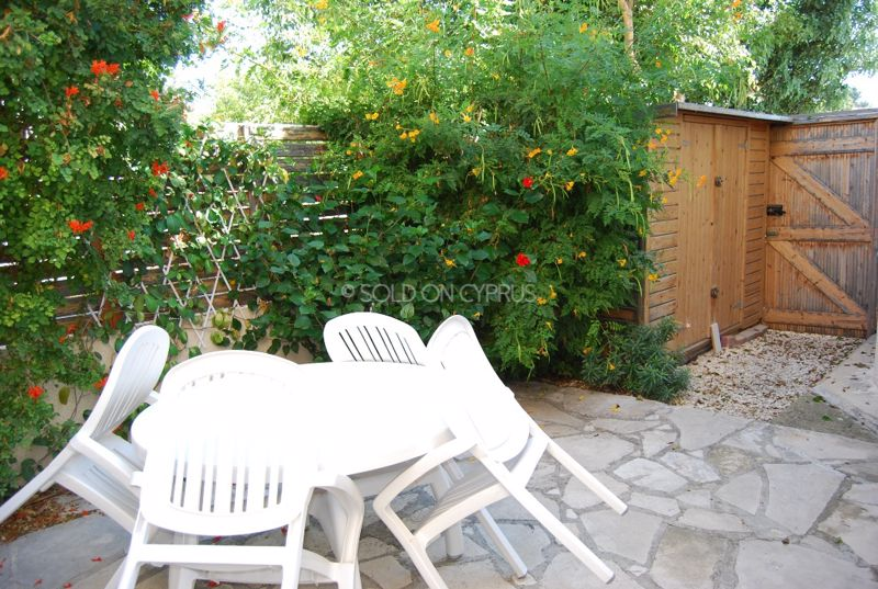 Side Patio With Storage Shed