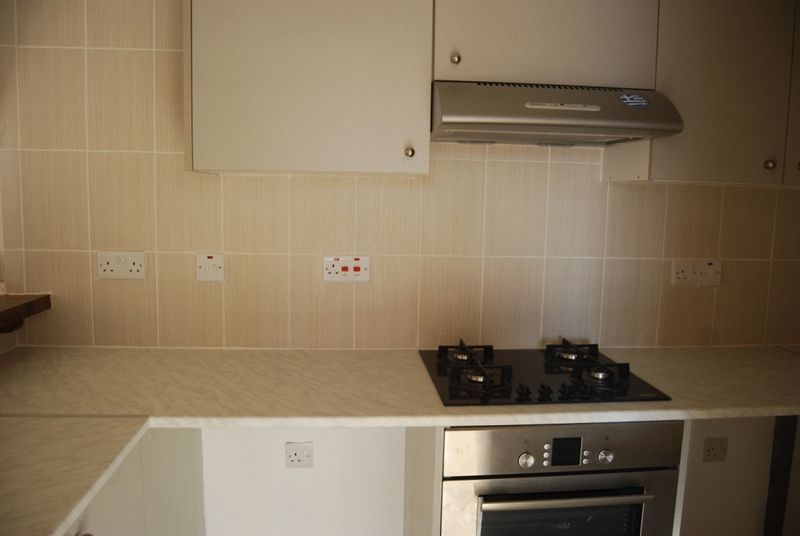 Newly Fitted Kitchen With Oven And Hob