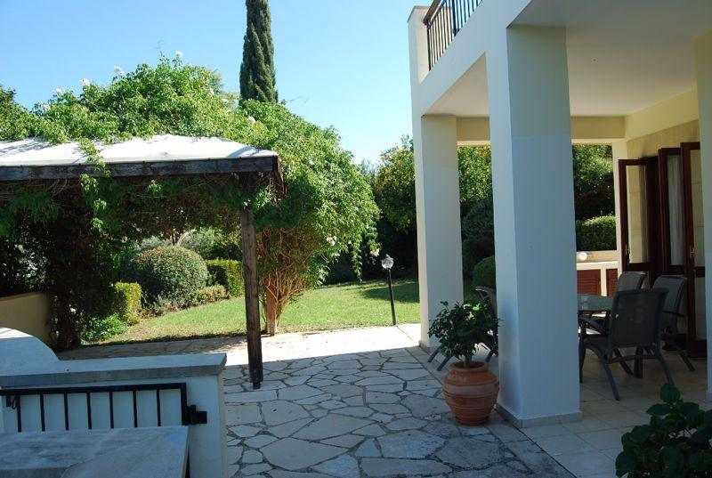 Permanent pergola providing shade for al fresco di