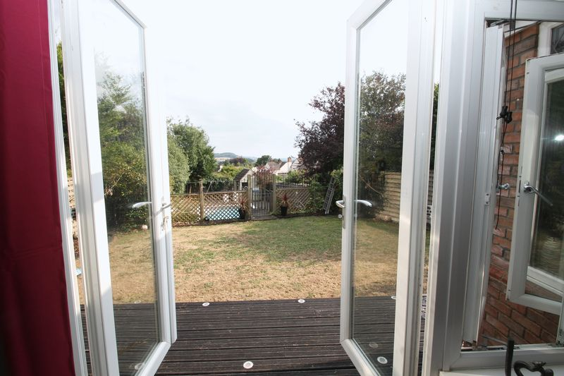 French doors from the garden into the rear garden