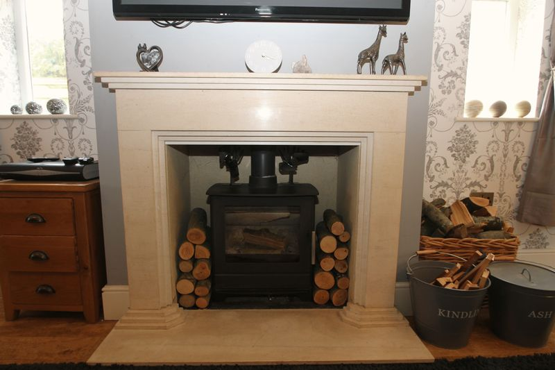 Feature fireplace with log burning stove inset