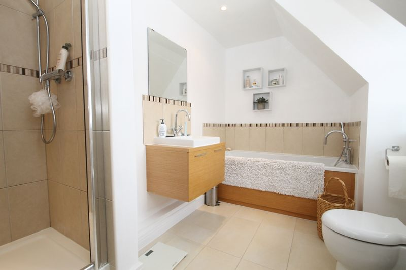 En suite bathroom with separate shower