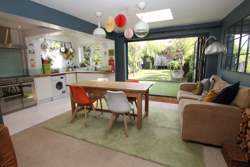 Dining area and kitchen with bi-fold doors to the