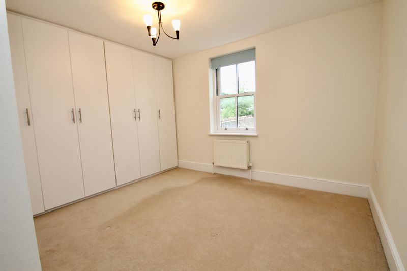 Bedroom with en suite and fitted wardrobes