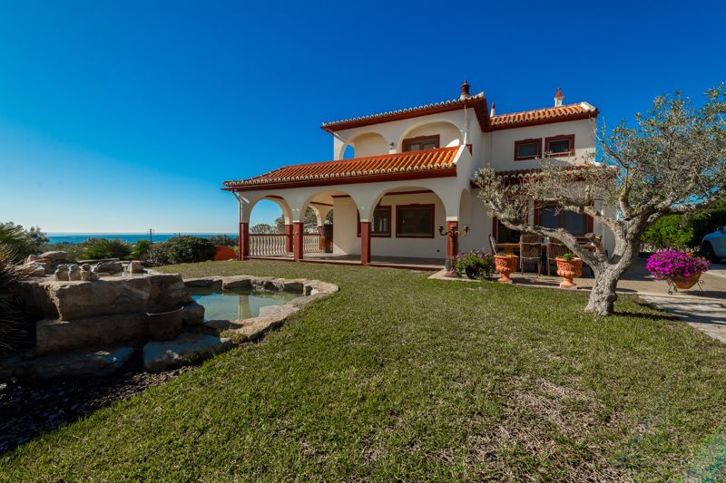 Ornamental pool, villa and view