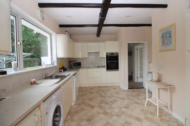 Kitchen with cream units and view to rear