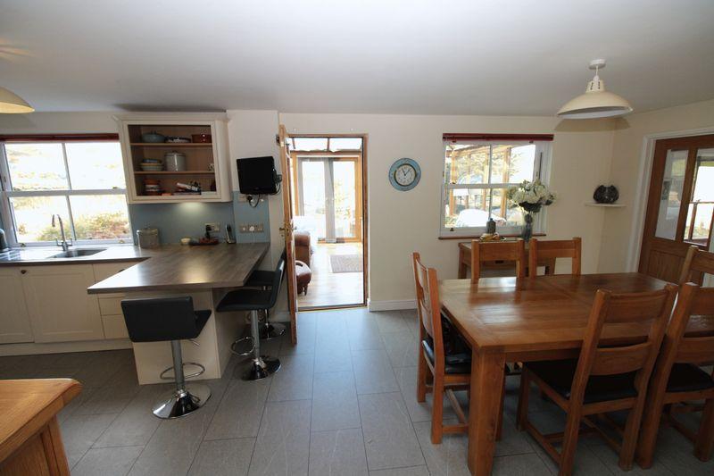 Open plan kitchen through to conservatory