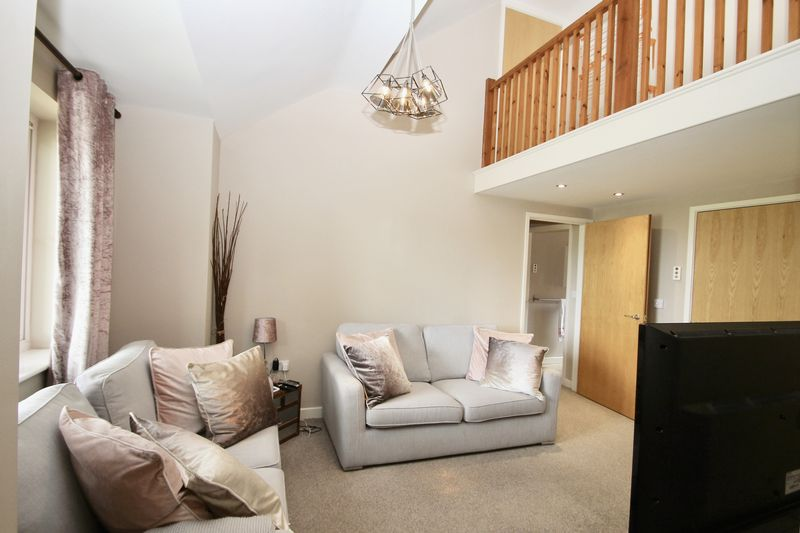 Sitting room with galleried landing above