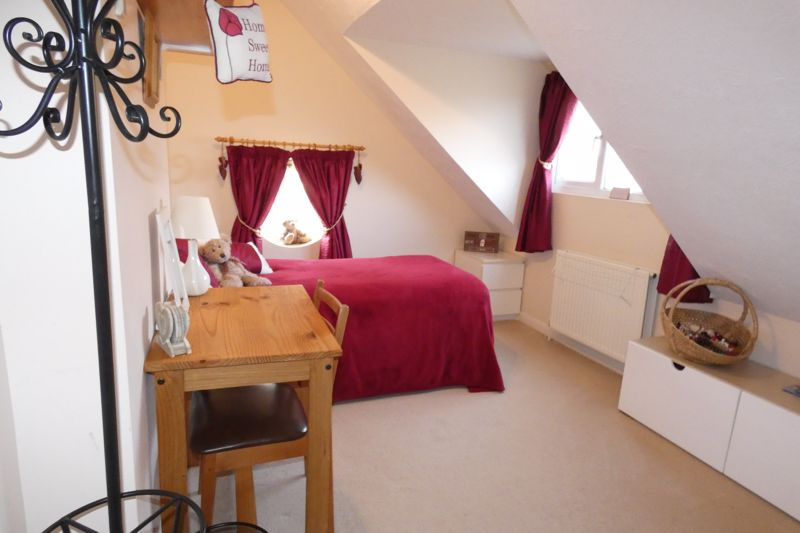 Bedroom with Character Angled Ceilings and Dorma W