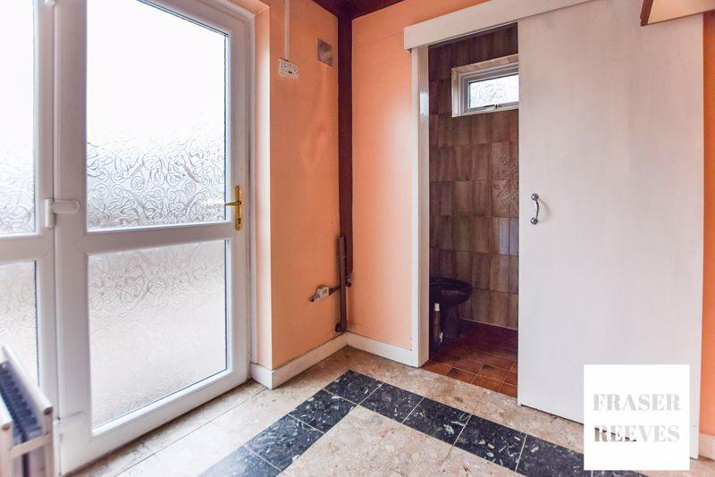Downstairs W/C and Door to Rear Garden