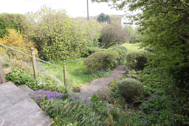 Steps down to Rear Garden