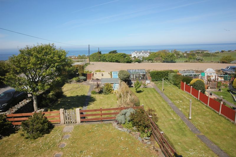 view over front garden to sea