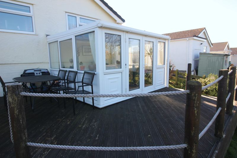 decking and sun room/conservatory