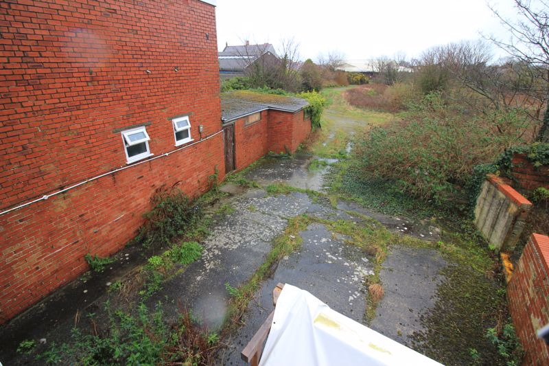 rear yard looking to storage outbuilding