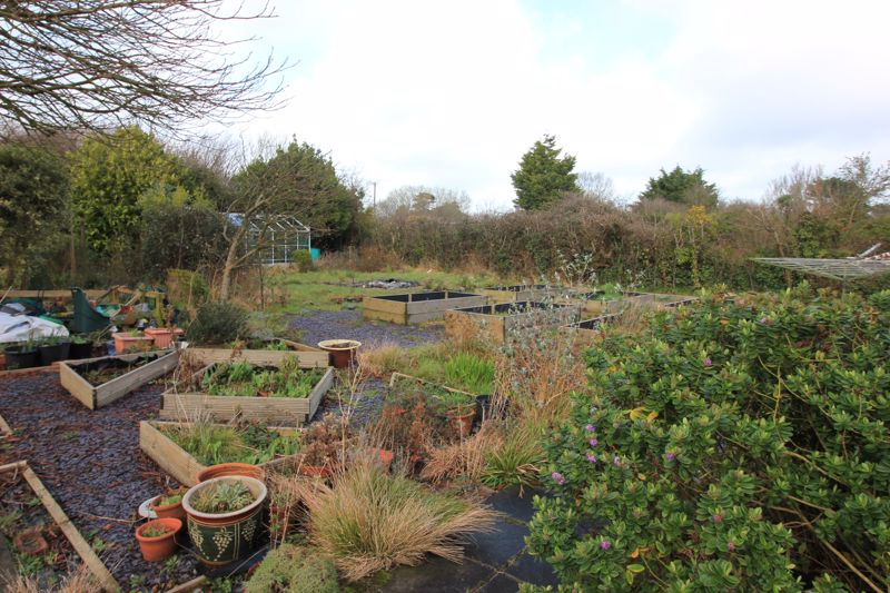 rear gardens/beds and greenhouse