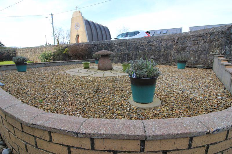 front stoned garden