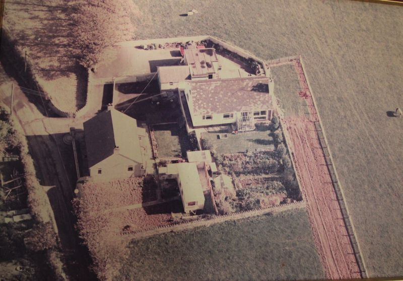 Old aerial view clearly showing side strip of land