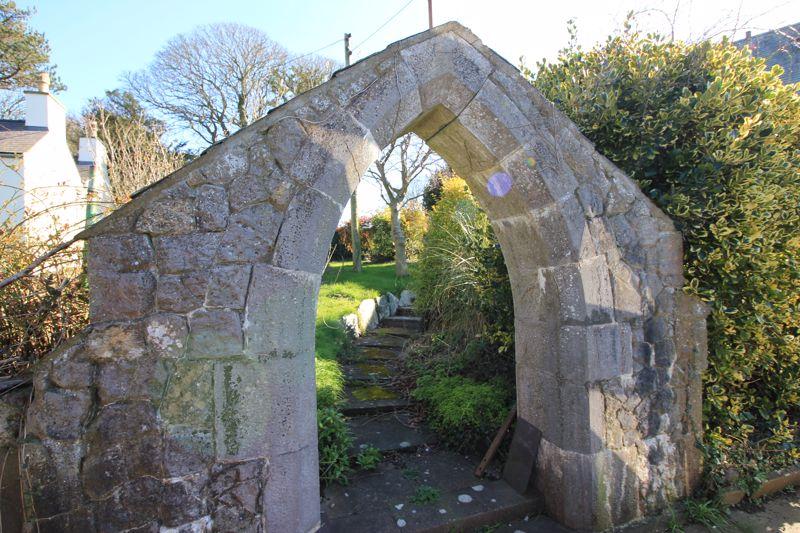 stone arch in garden