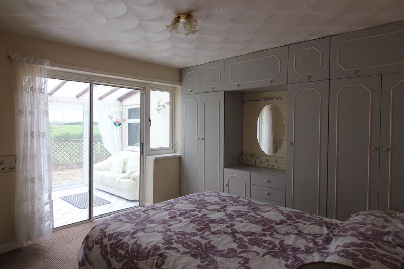Bedroom 1 thru to conservatory