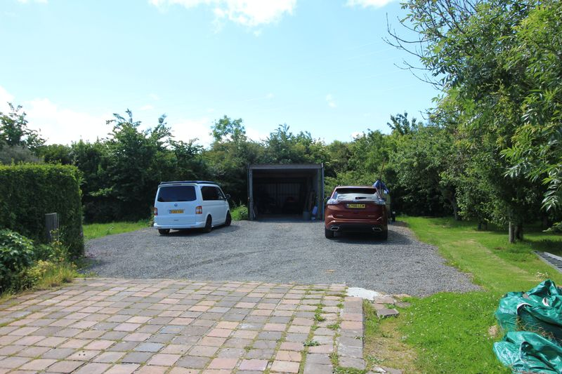 side parking and open barn/machinery shed