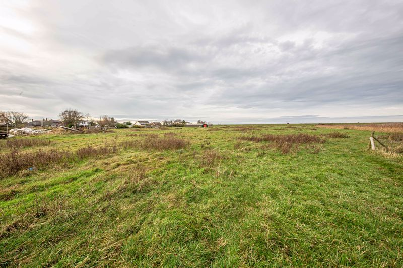 7 acre plot up and beyond sea wall