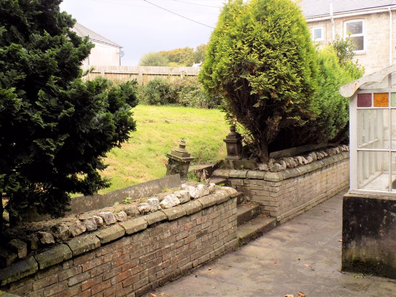 Entrance Porch with Steps to Garden