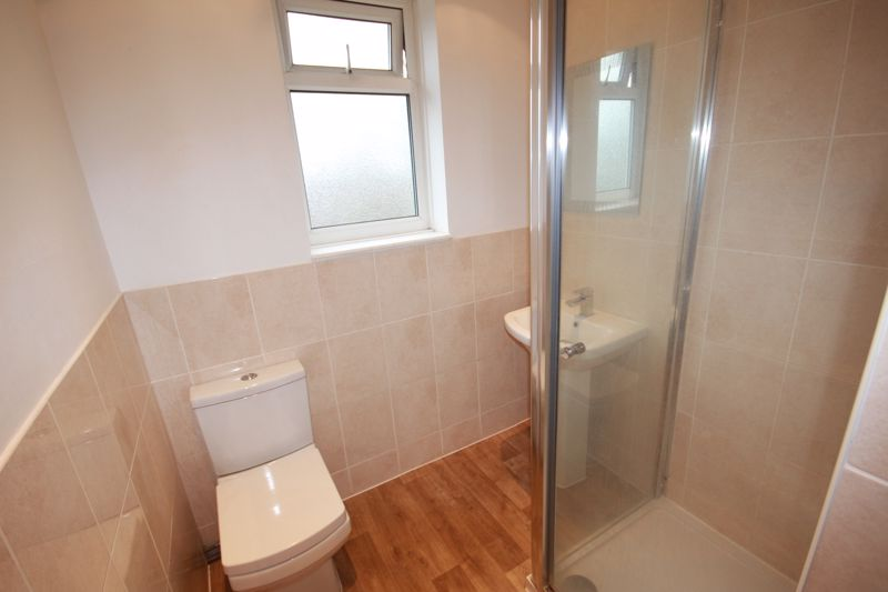 RE-FITTED SHOWER ROOM (REAR)