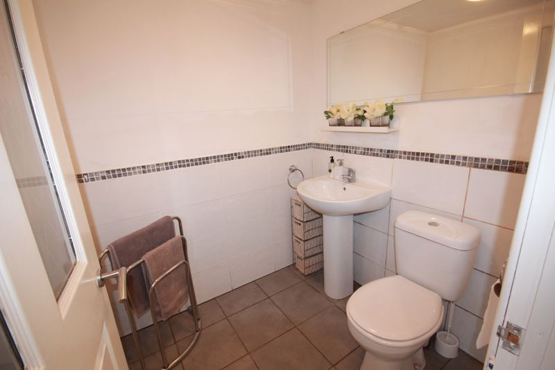 RE-FITTED BATHROOM (SIDE)