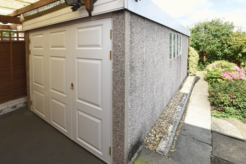 GARAGE AND SIDE OF REAR GARDEN