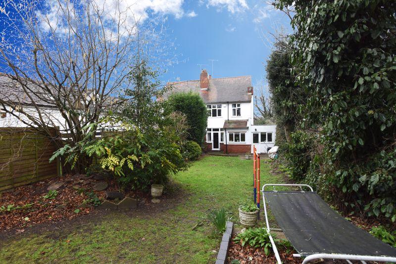 Rear garden to house view