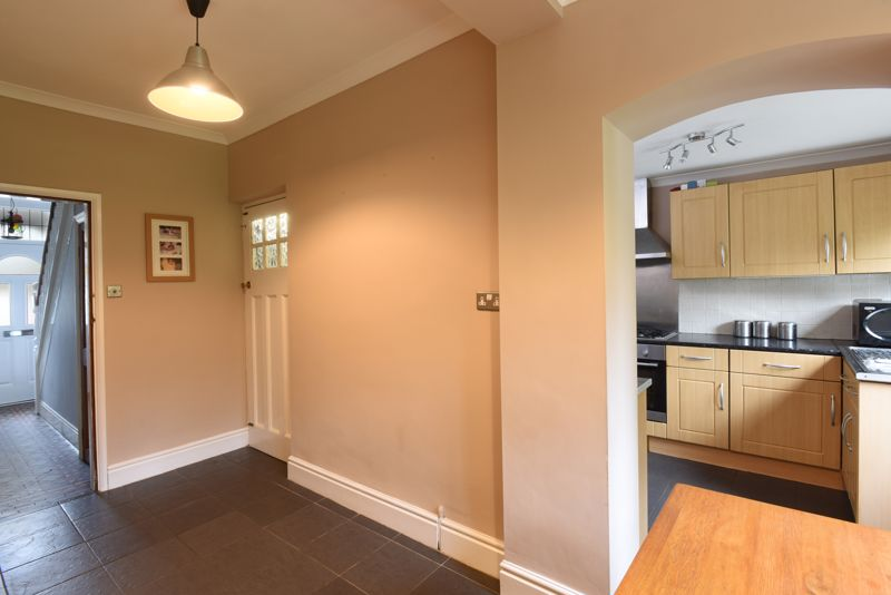 Dining area to kitchen and hall