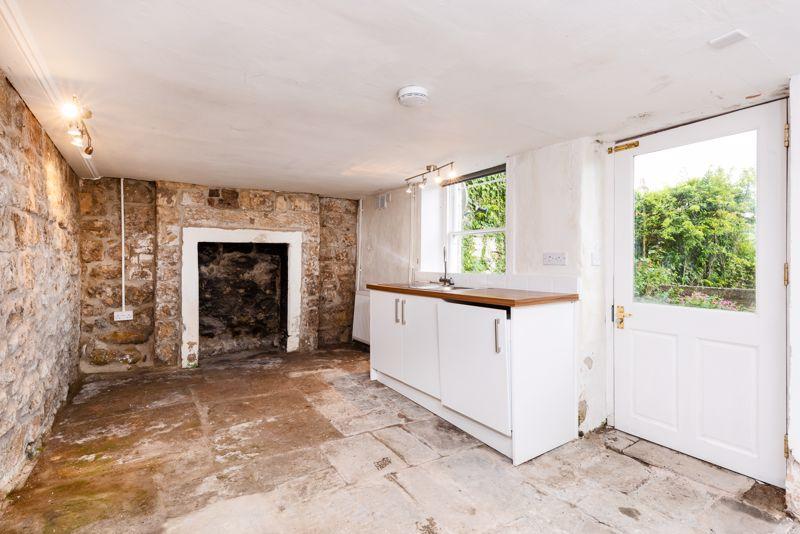 Basement Utility Room With Flagstone Floor