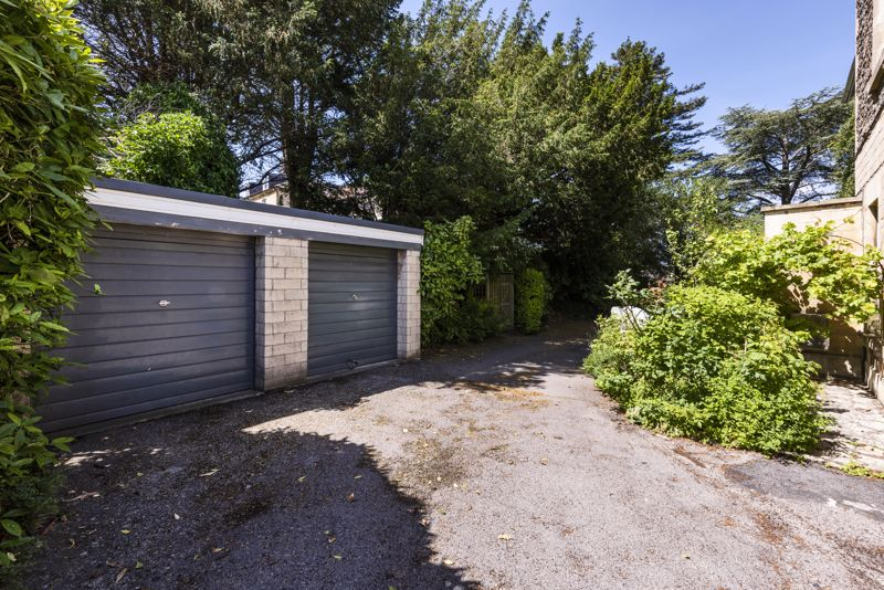 Single Garage to Left & Parking Space