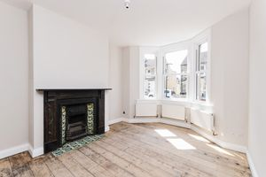 Bay Windowed Sitting Room with Period Fireplace