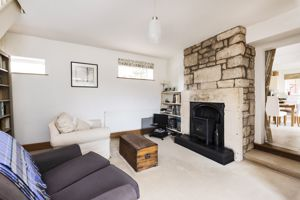Sitting Room With Stone Fireplace